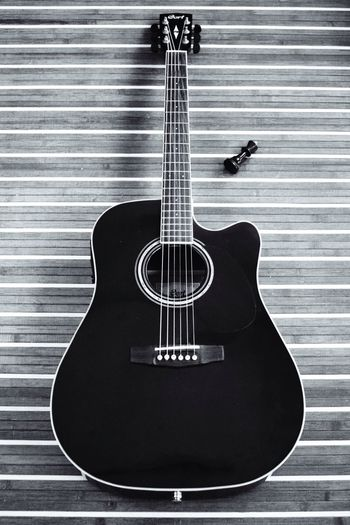 Black Beauty. Guitar Blackandwhite Vintage Wood Hobbies Noir Beautiful Beauty King Chess Chesspiece Music Strings String Instrument Acoustic Acousticguitar Story Noirphotography Perspective
