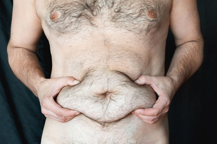 Midsection of man with hands