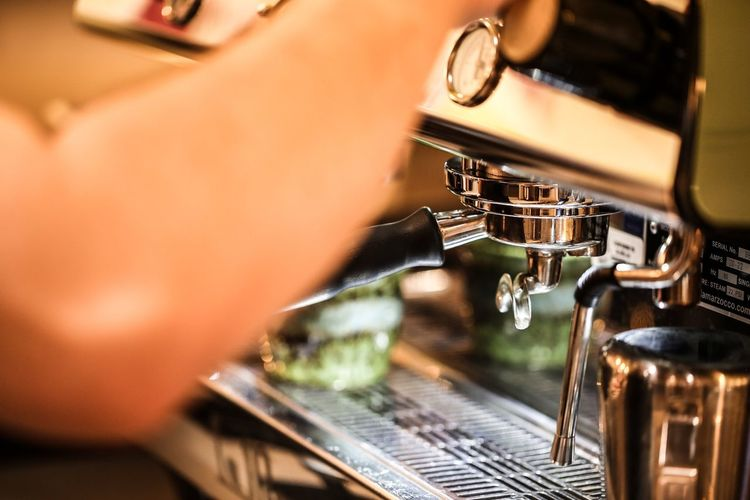 Barista's workbench. JGLowe EyeEm Selects Espresso Maker Machinery Coffee - Drink Cafe Preparation  Indoors  Barista Coffee Cup Selective Focus Close-up Food And Drink Motion Appliance No People Technology Day Freshness
