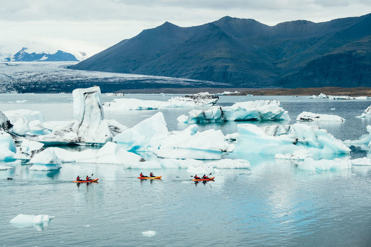 Iceland Kayaking Beauty In Nature Cold Cold Temperature Floating On Water Frozen Glacial Glacier Global Warming Ice Iceberg Kayak Lake Landscape Melting Mountain Nature Outdoors Scenics Snow Tranquil Scene Tranquility Waterfront Winter Done That. Lost In The Landscape Go Higher