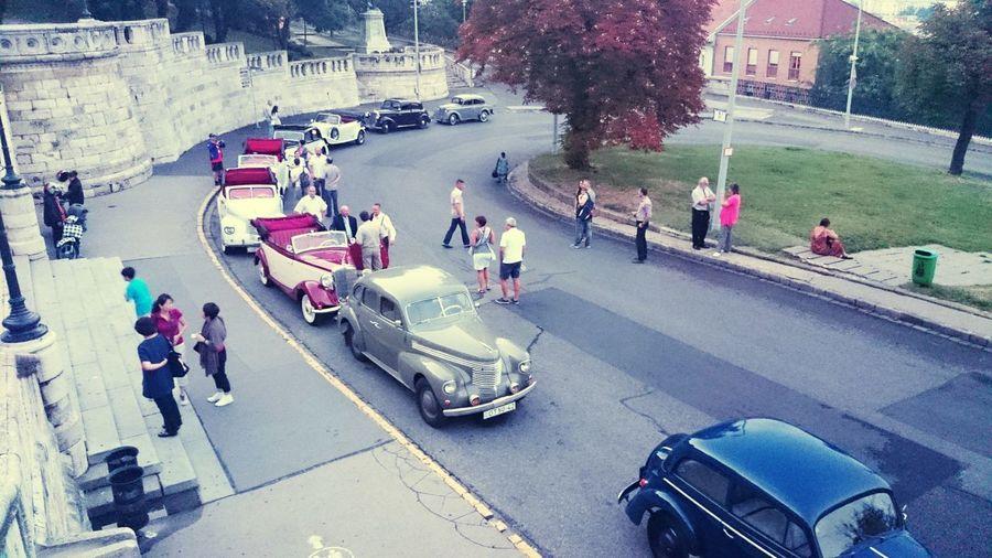 Vintage Cars City Men Women Road Crowd High Angle View Architecture Building Exterior Built Structure Vehicle