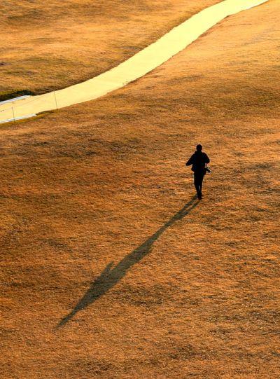 Full length of man running on field