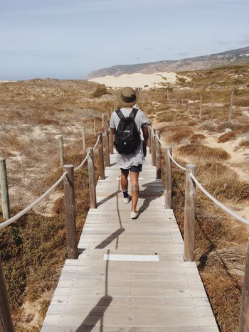 Full Length Rear View Mountain Railing Leisure Activity Steps The Way Forward Scenics Sky Tranquil Scene Young Adult Mountain Range Casual Clothing Tranquility Beauty In Nature Outdoors Non-urban Scene Nature Day Remote Portugal Lisbon Guincho Beach Road