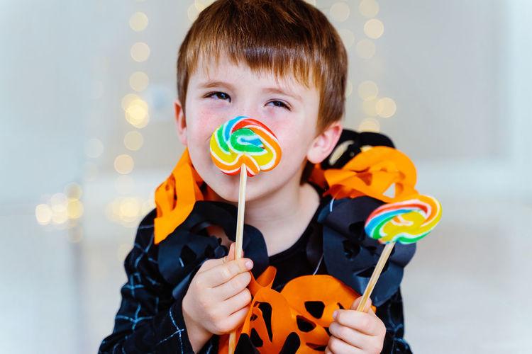 Portrait of boy holding bubbles