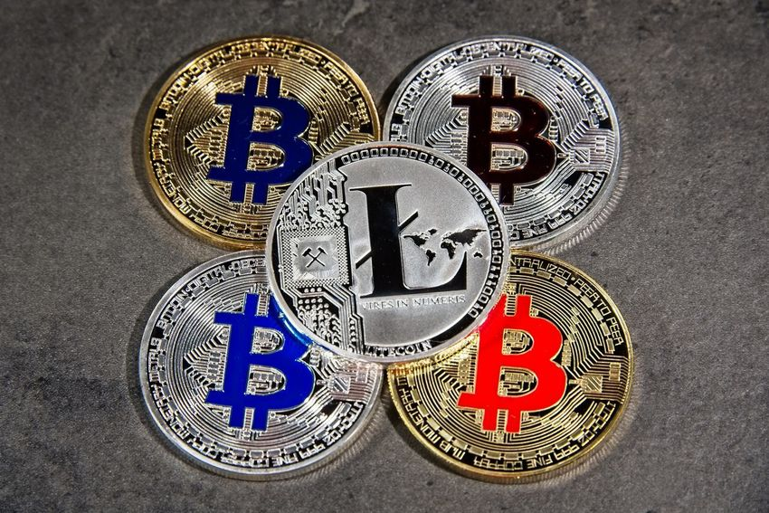 Shining silver metal BTC LTC Bitcoin Litecoin coins on grey background BTC Gold Taxi Virtual Reality Bitcoin Blockchain Coin Crypto Cryptocurrency Cryptography Digital Eth Ether Ethereum Exchange Finance Metal Silver