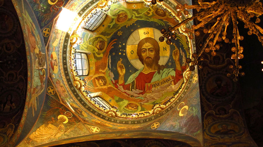 The magnificent painted dome - Interior of the Church of the Spilled Blood, Saint Petersburg, Russia Church Of The Spilled Blood Painted Ceiling Russian History Saint Petersburg, Russia Architecture Art And Craft Belief Building Built Structure Ceiling Church Dome Craft Creativity Female Likeness Gold Colored Human Representation Idol Indoors  Male Likeness Mural No People Ornate Place Of Worship Religion Representation Russian Orthodox Church Sculpture Spirituality Statue Adventures In The City The Traveler - 2018 EyeEm Awards