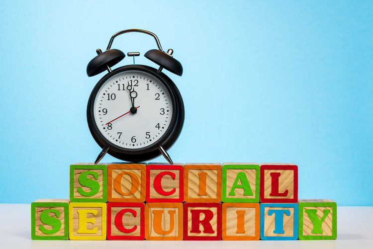 Alarm clock concept for the problems of Social Security system running out of money in the future and not being able to support retirees Delay Government Reform Alarm Alarm Clock Clock Congress Exhausted Funding Midnight Money No People Pension Problem Retirement Social Security Time Time Running Out Trust Fund Urgency