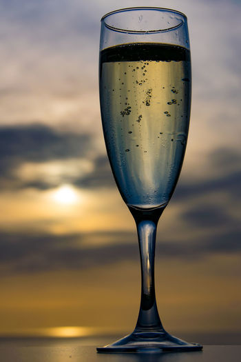 Champagne celebration at sunset