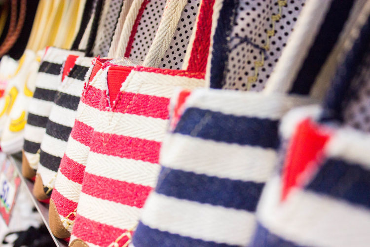 Backgrounds Close-up Day Flag Full Frame Indoors  Multi Colored No People Patriotism Pattern Red Retail  Selective Focus Sport Store Striped Textile Variation White Color