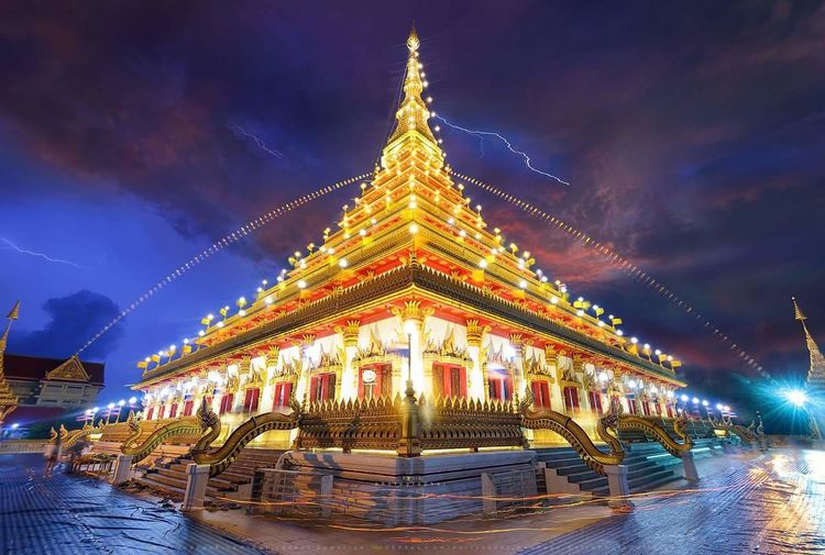 Low Angle View Of Illuminated Temple Against Cloudy Sky At Night