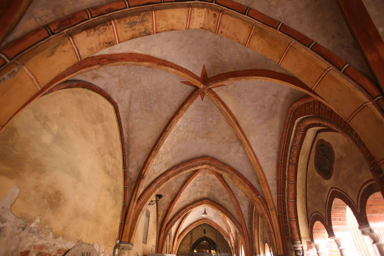 Low angle view of ribbed vault ceiling at church