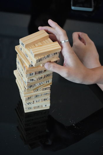 Rear view of a boy playing stack