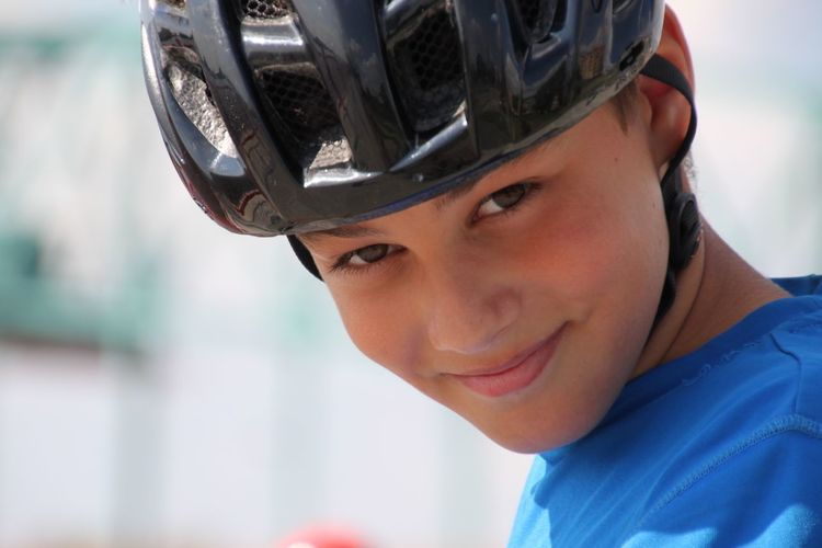 Portrait of smiling teenage boy wearing helmet