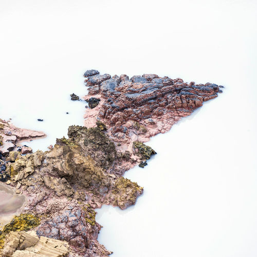 Aerial view of rock formation in lake
