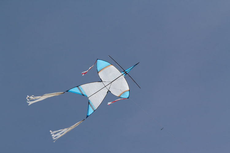 Art And Craft Blue Clear Sky Copy Space Creativity Day Environment Flying Kite Kite - Toy Low Angle View Mid-air Motion Multi Colored Nature No People Outdoors Sky Sunlight Wind