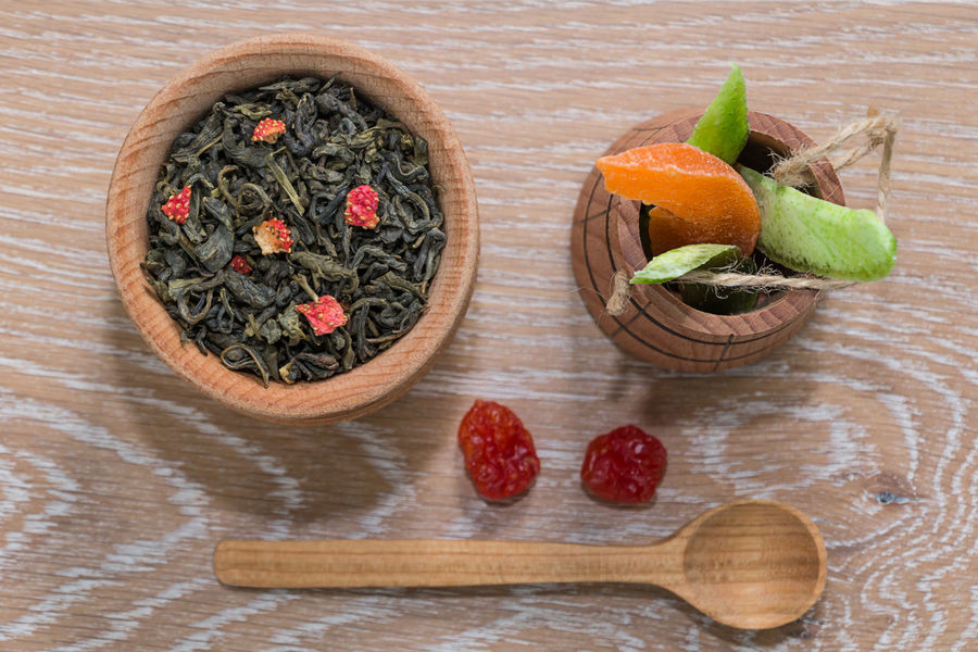 green tea and dried fruits on a wooden surface Flat Lay Beverage Breakfast Detox Rustic Slim Tea Thirst Antioxidant Background Berry Blurred Background Blurry Dehydration Drink Dry Drying Fruits Fruit Green Tea Leaf Morning Rituals Rejuvenation Slimming Vegan Vitamin Wooden Leaves Dried Fruit Tea Leaves Tea Ceremony