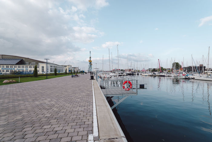 boats moored at harbor against sky Baltic Sea Mecklenburg-Vorpommern Travel Water Reflections Wismar Harbor Architecture Boats Building Exterior Built Structure City Cloud - Sky Day Germany Nature No People Ocean Outdoors Sea Sky Water Waterfront Wismar