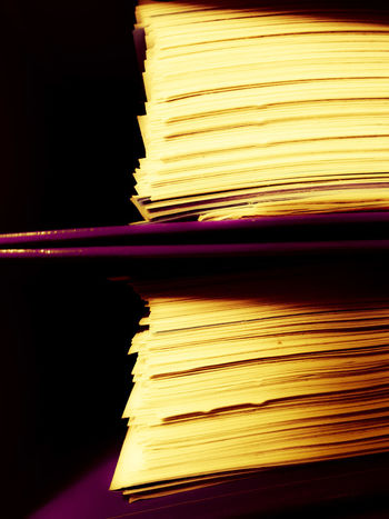 Two file folders Yellowish Shades Shadows & Light Purple Violet Reading Advertising Paper Document Dossier Record Copy Space Centered Perspective Centered Files Folders File Folders Pages Pages Of A Book Zoom Marketing Script Paperwork Paperweight Black Background Close-up Abstract Backgrounds Abstract Printing Press Printing Out