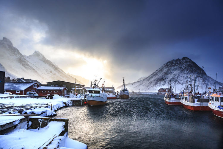 Lofoten Islands in Norway at winter time Lofoten Islands Norway Winter Beauty In Nature Cloud - Sky Coast Cold Temperature Mode Of Transportation Mountain Mountain Range Nature Nautical Vessel No People Northsea Outdoors Scenics - Nature Sky Snow Snowcapped Mountain Tranquil Scene Tranquility Transportation Water Waterfront Winter