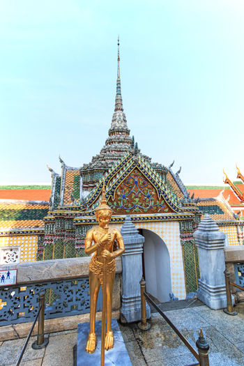 A Golden Kinnari statue att he Temple of the Emerald Buddha (Wat Phra Kaew) , Bangkok, Thailand Ancient Architecture Bangkok Thailand. Built Structure Day Emerald Buddha Temple No People Ornate Outdoors Sky Temple Temple - Building The Past Tourism Travel Destinations Wat Phra Kaew