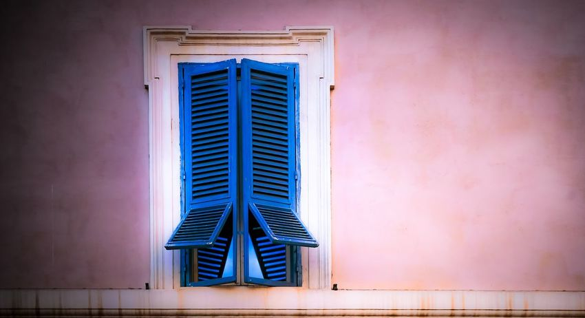 Blue shutters Architecture Window Built Structure No People Outdoors Day Blue Building Exterior Close-up Wooden Shutters Windows Blue Shutters Pink Wall Lookingup Travel Destinations Reflections In The Glass Windows Reflections Rome Rome, Italy EyeEmNewHere Colour Your Horizn Colour Your Horizn