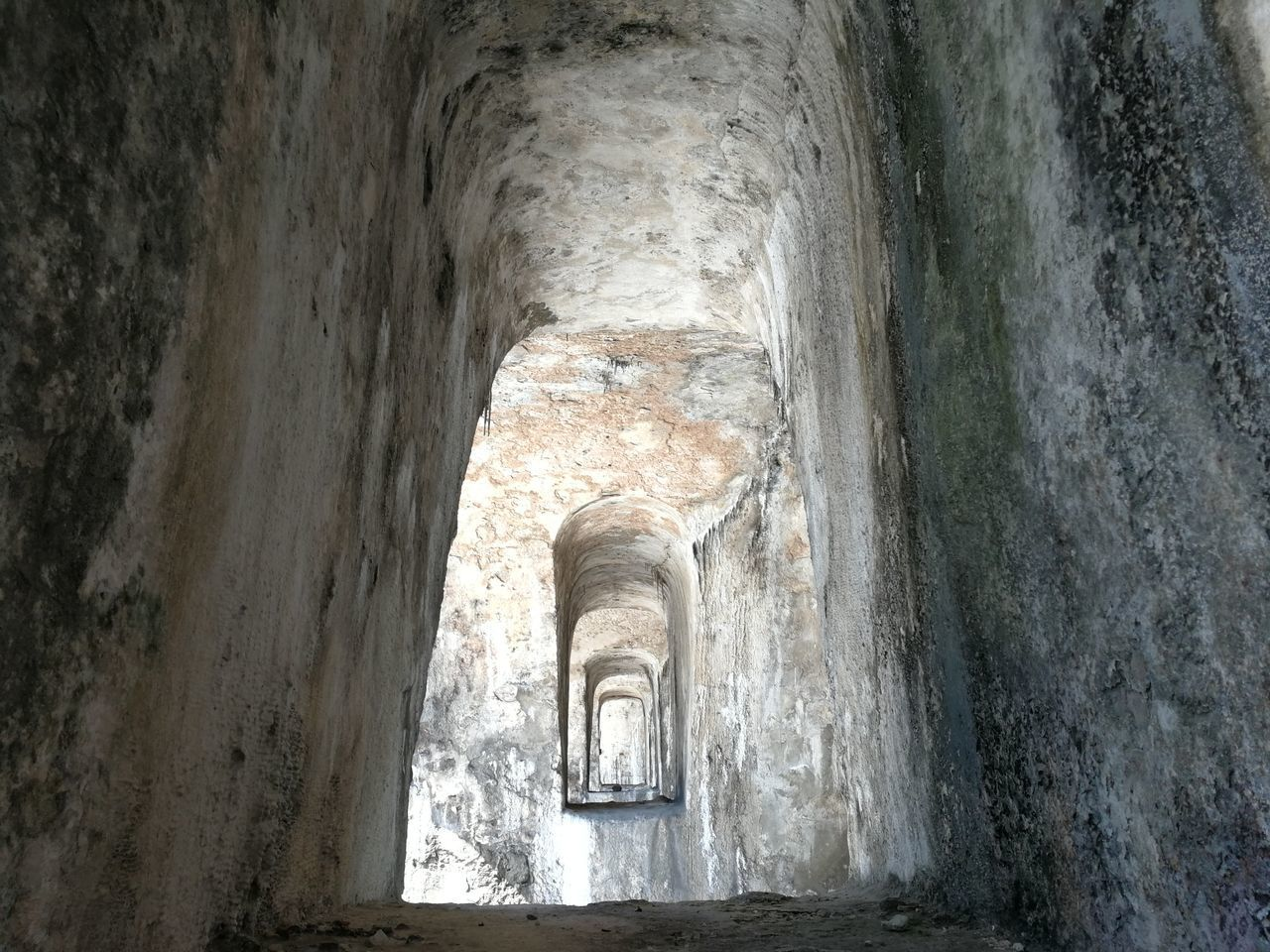 architecture, history, built structure, the past, arch, no people, day, old, ancient, building, indoors, weathered, solid, tunnel, ancient civilization, wall, wall - building feature, travel destinations, abandoned, ruined, ceiling, archaeology
