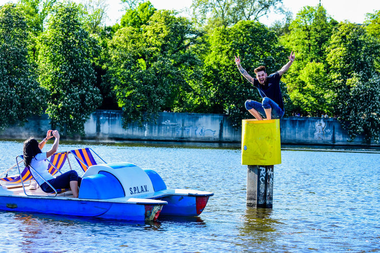 Arms Raised Boys Child Day Human Arm Inflatable  Lake Leisure Activity Lifestyles Men Mode Of Transportation Nature Nautical Vessel Outdoors Plant Real People Togetherness Transportation Tree Water Waterfront