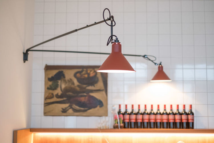 Close-up of illuminated pendant light hanging on table at home