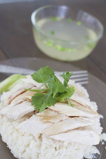 Close-up of rice with chicken in plate on table