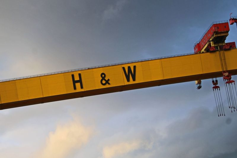 Hello and welcome Titanic Quarter Shipyard Harland And Wolff Crane Crane - Construction Machinery Sky Low Angle View Cloud - Sky Nature No People Outdoors Architecture Built Structure Sign Building Exterior Connection Western Script Text Communication Yellow Dusk Number Transportation Metal Day
