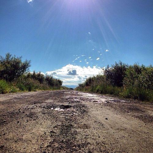 Empty road leading towards sea