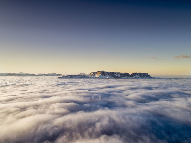 An island inside a ocean of clouds Bavaria Cloud DJI X Eyeem Above The Clouds Aerial Aerial Photography Bavarian Alps Beauty In Nature Blue Clear Sky Clouds And Sky Day Germany Landscape Mountain Range Nature No People Outdoors Scenics Sea Sky Sunset Tranquil Scene Tranquility Shades Of Winter