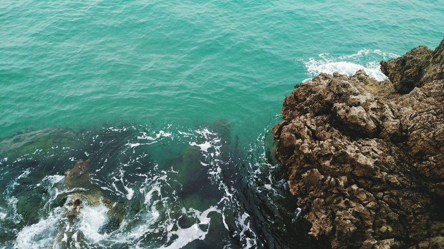High angle view of rock at sea shore