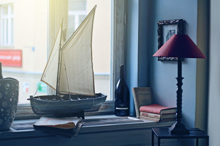 Living Room Decoration Books Objects Still Life Photography Arrangement Boat Book Bottle Indoors  Lamp Living Room Still Life Window