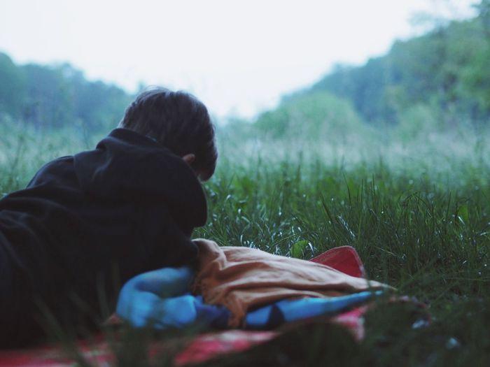 Man relaxing on grassy field