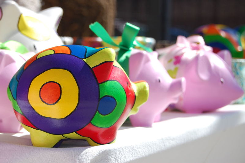 Close-Up Of Colorful Piggy Banks On Table