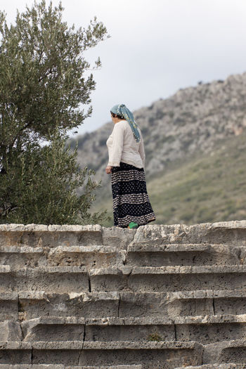Turkish Woman walking on the amphitheater of Kas, Turkey Amphitheater Ancient Architecture Full Length Headscarf Islam Kas Long Skirt Mature Adult Mature Women Muslim Muslimah Old One Woman Only Outdoors Rural Scene Solitude Steps Steps And Staircases The Past Tradition Traditional Clothing Turkey Turkish Walking Women