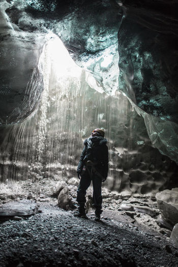 Adult Adults Only Adventure Backpack Beauty In Nature Cave Day Full Length Glacier Hiking Icecave Men Mountain Nature One Man Only One Person Outdoors People Real People Rear View Rock - Object Standing Waterfall The Traveler - 2018 EyeEm Awards