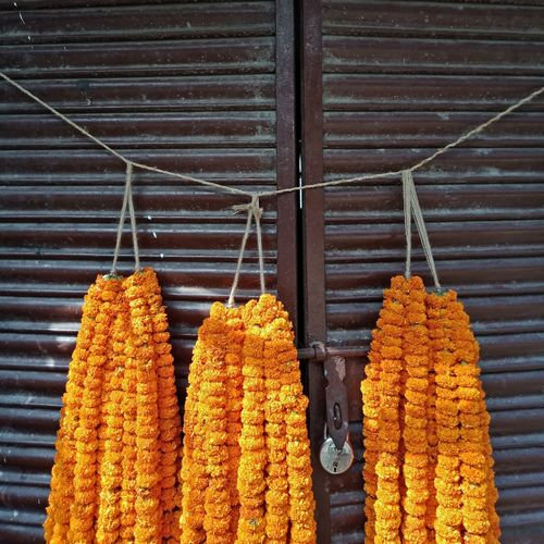 Floral garland hanging from rope for sale