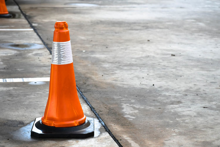 High angle view of traffic cone on road in city