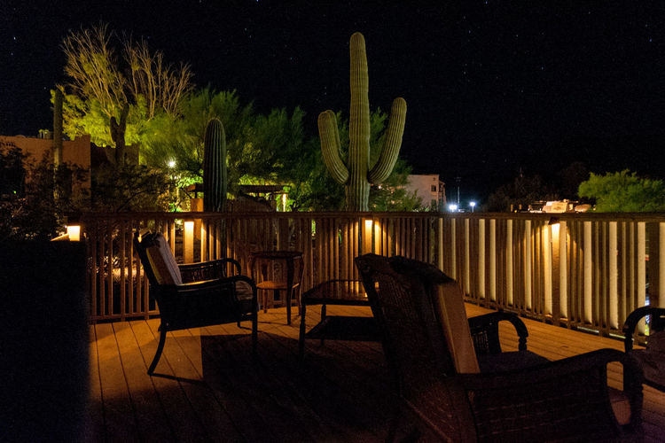 Mira Vista Clothing Optional Resort sundeck Mira Vista Clothing Optional Resort Arizona Absence Architecture Business Cactus Chair Empty Growth Illuminated Nature Night No People Outdoors Plant Seat Setting Sky Table Tree Water Wood - Material Tourist Resort