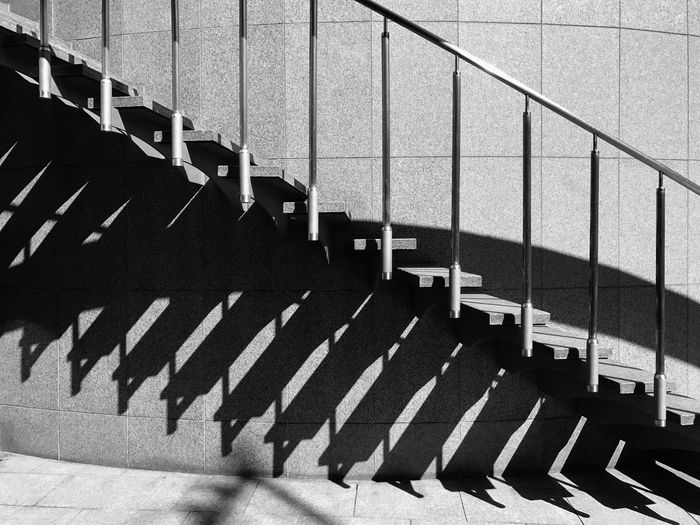 Sunlight Falling On Steps By Building