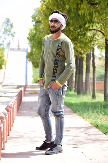 Greenobsessed Lovegreen One Person One Young Man Only Casual Clothing Fashion Outdoors Lifestyles Day Tree Summer One Man Only Handsome Relaxation standing