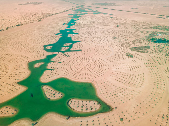 Man Made Pattern Land No People Aerial View Desert Green Color Day High Angle View Sand Nature Outdoors Water Full Frame Landscape Travel Destinations Design Business Building Exterior Plant Arid Climate