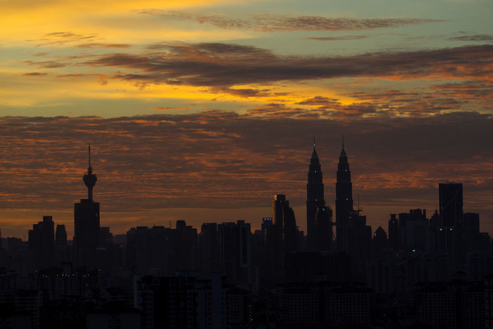 Dramatic scenery of the Kuala Lumpur city at sunset, view from Ampang city. Architecture Building Exterior Built Structure City Cityscape Kuala Lumpur Malaysia  Kuala Lumpur Tower Kuala Lumpur Twin Tower Modern No People Outdoors Petronas Twin Towers Sky Skyscraper Sunset Tower Travel Travel Destinations Urban Skyline