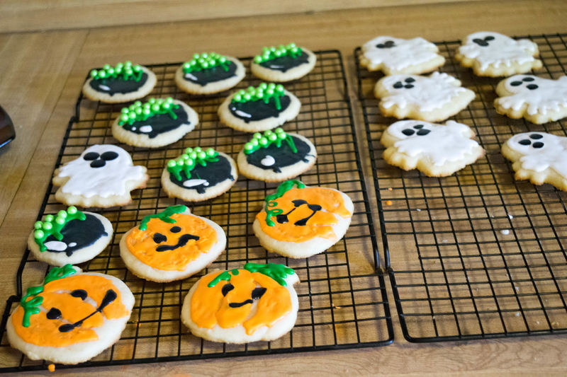 Baked Goods Cookies Halloween Halloween Treats SugarCookies Treats Close-up Cookie Cupcake Day Dessert Festive Food Food And Drink Freshness High Angle View In A Row Indoors  Indulgence No People Ready-to-eat Still Life Sugar Cookies Sweet Food Table Temptation Unhealthy Eating Variation Wood - Material