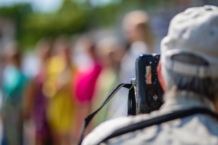 Photographer photographing people with camera