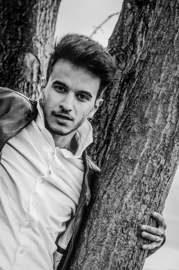 Casual Clothing Day Focus On Foreground Leisure Activity Lifestyles Looking At Camera Men Model Nature One Person Plant Portrait Real People Smiling Teenager Tree Tree Trunk Trunk Young Adult Young Men