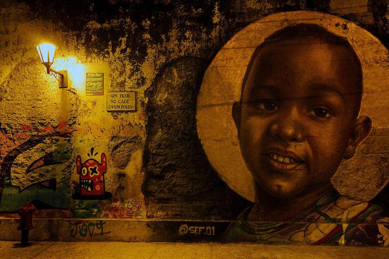 Portrait of boy against wall