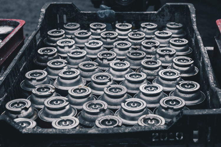 High Angle View Of Aerosol Cans In Crate